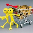 Smilies with shopping carts and coins — Stock Photo #6818371