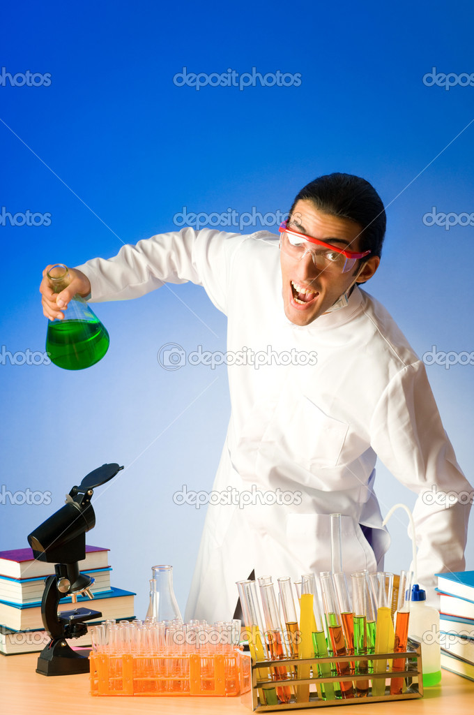 Chemist in the lab experimenting with solutions — Stock Photo #6817712