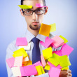 Young businessman with reminder notes — Stock Photo #6836667