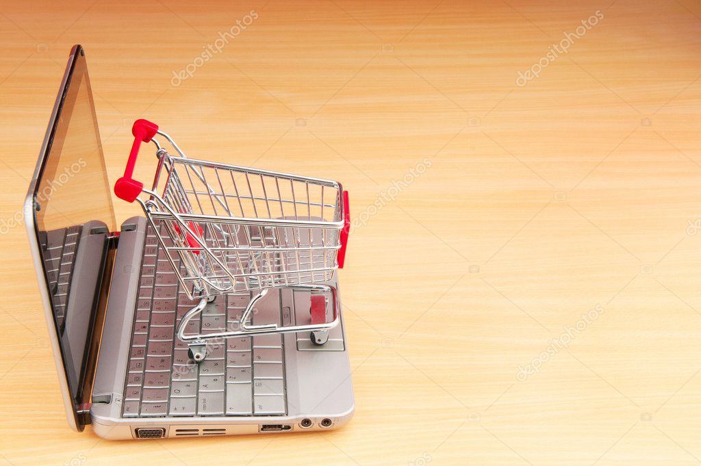 Shopping online with computer and cart — Stock Photo #6837282