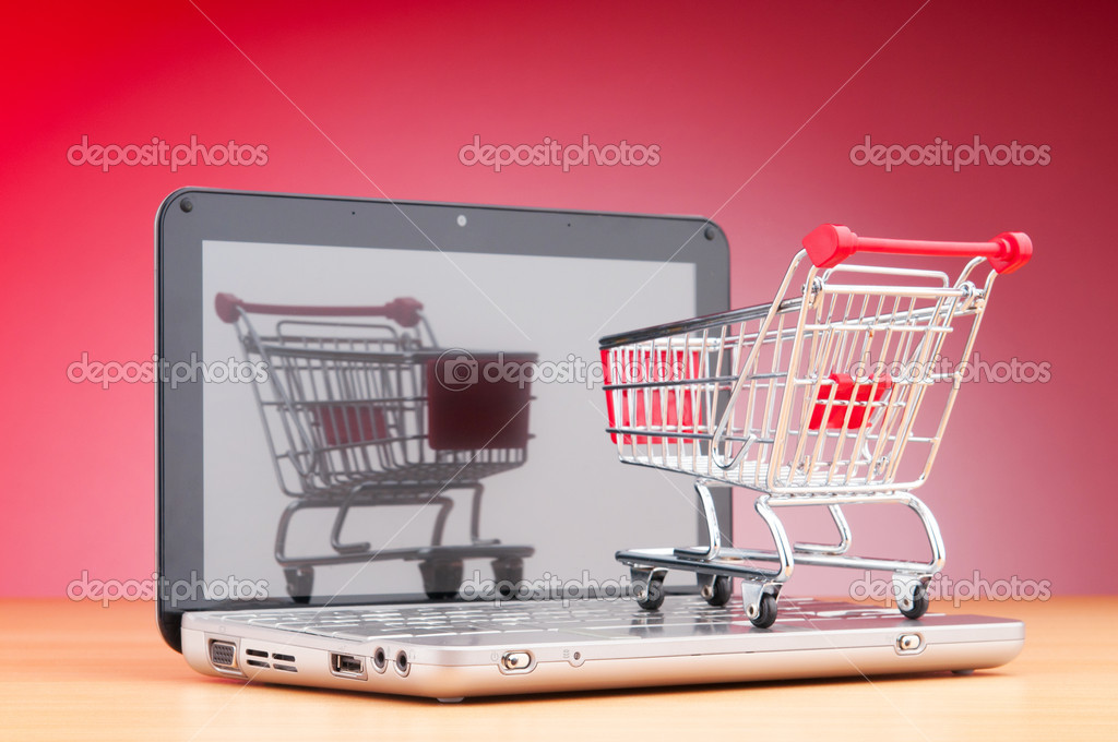 Shopping online with computer and cart — Stock Photo #6837606