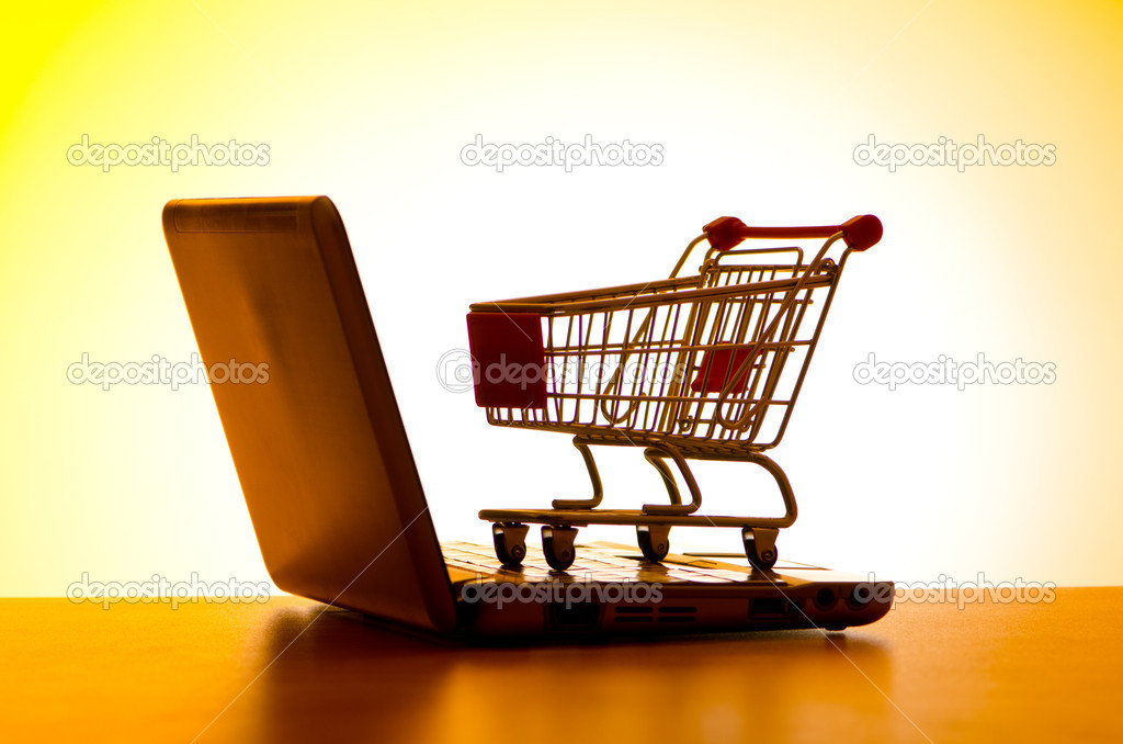 Silhoette of shopping cart and laptop — Stock Photo #6838192
