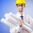 Young engineer working with drawings — Stock Photo #6842700