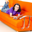 Student working with laptop sitting on sofa — Stock Photo #6842786