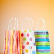 Shopping bags against gradient background — Stock Photo #6842991