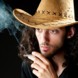 Man in cowbow hat smoking — Stock Photo #6843175