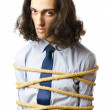 Young businessman tied with rope — Stock Photo #6843622