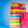 Stock Photo: Shopping bags against gradient background