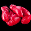 Red boxing gloves isolated on black — Stock Photo