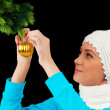 Young girl decorating christmas tree isolated on black — Stock Photo