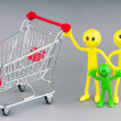 Shopping cart and happy smilies — Stock Photo #6845032