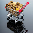 Shopping cart and gold coins — Stock Photo #6846495