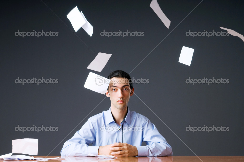 Flying paper and businessman in office — Stock Photo #6841320