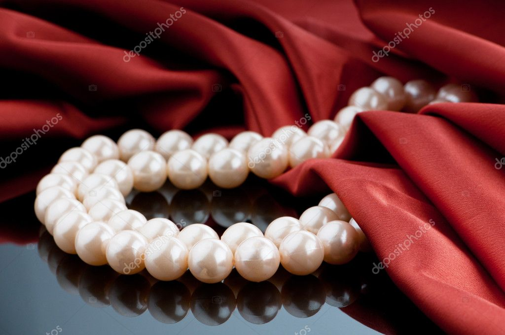 Pearls necklace on satin background  Stock Photo #6841506