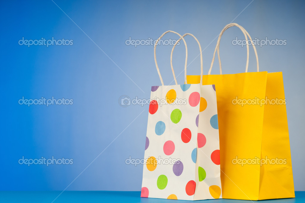 Shopping bags against gradient background — Stock Photo #6843681