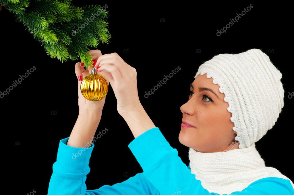 Young girl decorating christmas tree isolated on black  Stock Photo #6844576