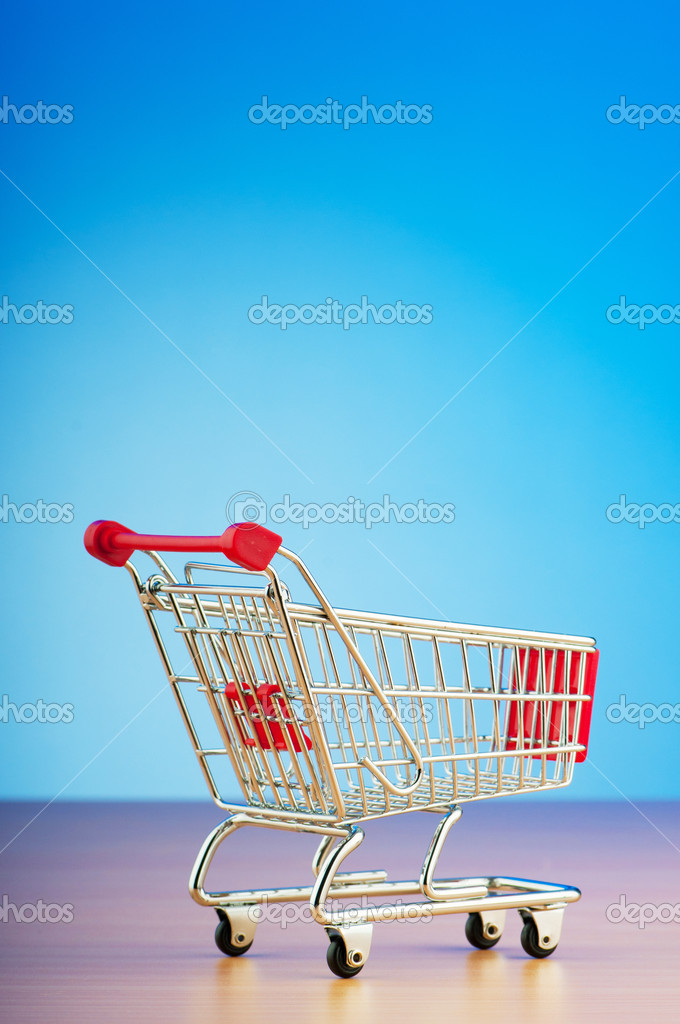 Mini shopping cart against gradient background — Zdjęcie stockowe #6845027