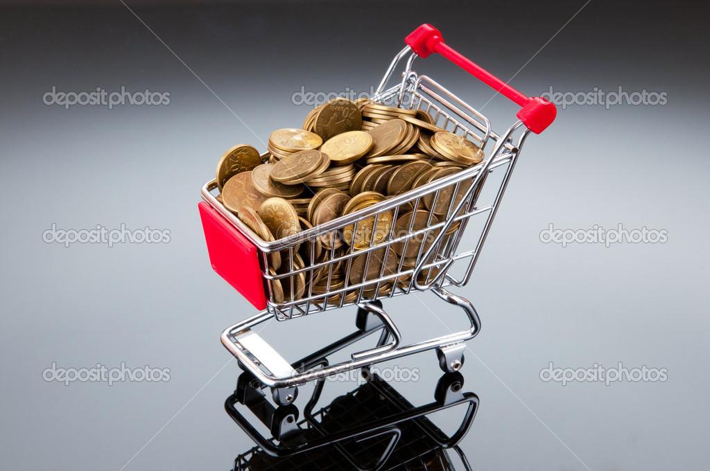 Shopping cart and gold coins — Stock Photo #6846479