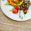 Plate with tasty lamp kebabs — 图库照片 #6884722