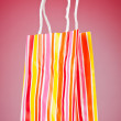 Shopping bags against gradient background — Stock Photo #6888362