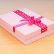 Christmas concept with giftbox on table — Stock fotografie