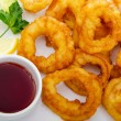 Fried calamari rings served with sauce — Stock Photo #6889262