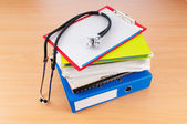 Medicine concept with stethoscope and books — Stock Photo