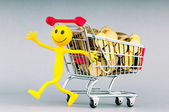 Smilies with shopping carts and coins — Stock Photo