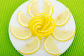 Lemon slices served in the plate — Stock Photo