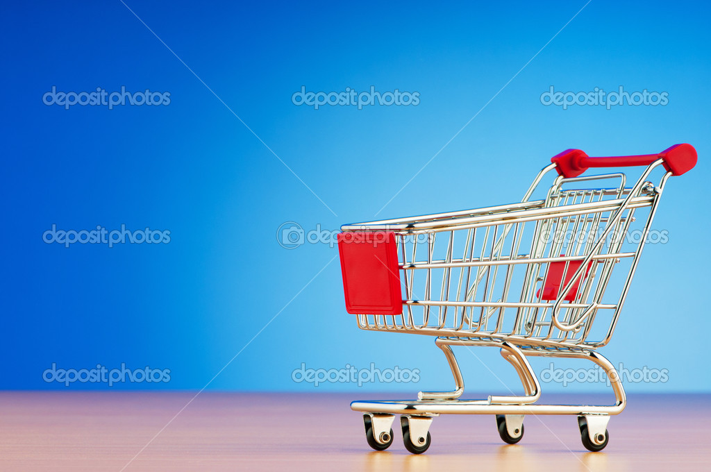 Mini shopping cart against gradient background — Photo #6882089