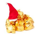 gyllene säckar med santa hatt — Stockfoto