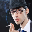 Young man smoking cigarette — Stock Photo #6894786