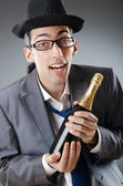 Businessman with bottle of champagne — Stock Photo