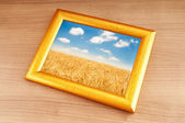 Wheat field in the picture frame — Stock Photo