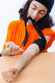 Young druc addict with syringe — Stock Photo