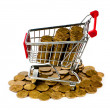 Gold coins in shopping cart — Stock Photo #7128094