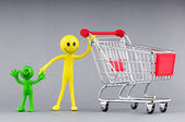 Shopping cart and happy smilies — Stockfoto