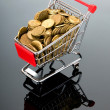 Shopping cart and gold coins — Stock Photo