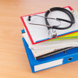 Stock Photo: Medicine concept with stethoscope and books