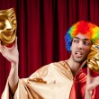 Actor with maks in a funny theater concept - Stock Photo