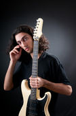 Guitar player against the dark background — Stock Photo