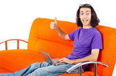 Student working with laptop sitting on sofa — Stock Photo