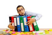 Businessman with many folders on white — Stock Photo