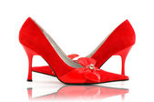 Elegant red shoes on the white — Stock Photo