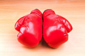 Boxing gloves on the table — Stock Photo