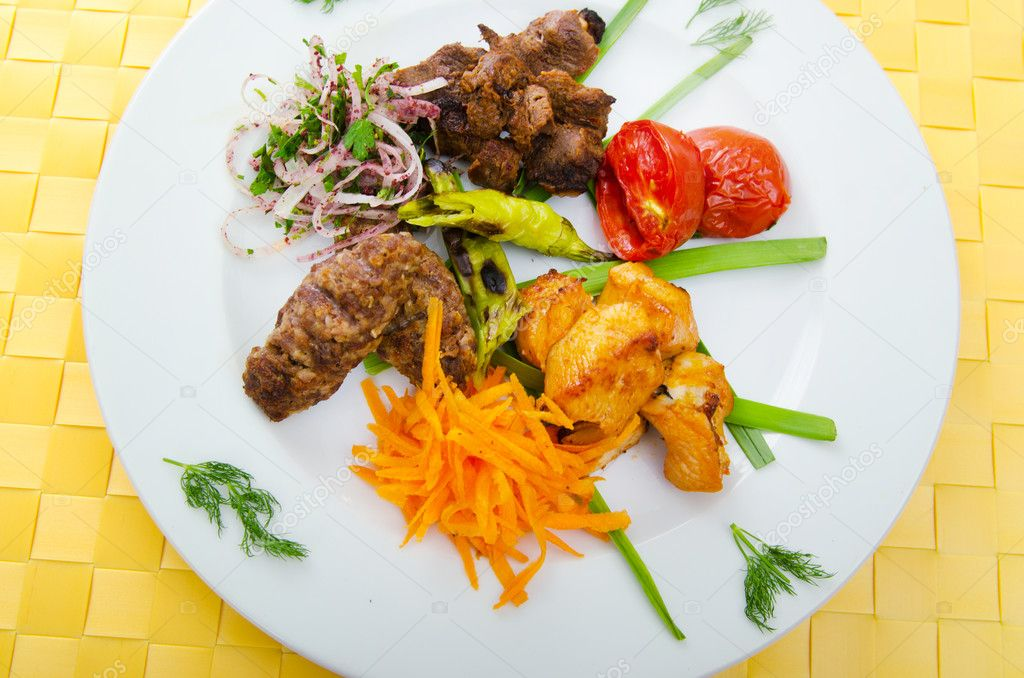 Plate with tasty lamp kebabs — Stock Photo #7137751