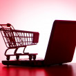 Silhoette of laptop and shopping cart — Stock Photo #7206864