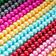 Abstract with colourful pearl necklaces — Stock Photo #7208873