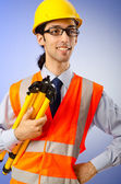 Young construction worker with hard hat — Stockfoto