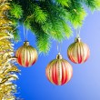 Baubles on christmas tree in celebration concept — Stockfoto